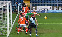 Goalkeeper Elliot Justham of Luton Town punches clear during the Sky Bet League 2 match between Wycombe Wanderers and Luton Town at Adams Park, High Wycombe, England on 6 February 2016. Photo by Kevin Prescod.