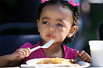Adrianna Haskins, 2, enjoys her breakfast at the Summer Reading Program Pancake Breakfast Kick-Off at the Carson City Library, in Carson City, Nev., on Saturday, June 8, 2013. <br /> Photo by Cathleen Allison