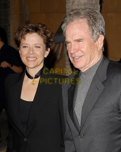ANNETTE BENING & WARREN BEATTY.The Sony Picture Classics L.A. Premiere of 'Mother and Child' held at The Egyptian Theatre in Hollywood, California on .April 19th, 2010                 .half length black grey gray blazer suit jacket choker necklace married husband wife .CAP/RKE/DVS.©DVS/RockinExposures/Capital Pictures.