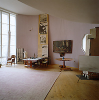 The living room/studio is on a grand scale and houses a collection of original paintings, drawings and photographs