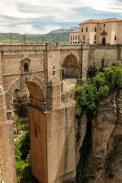 In the hill town of Ronda, the New Bridge spans the 360 feet deep gorge, which separates the whitewashed old Moorish town and the new town, El Mercadillo.