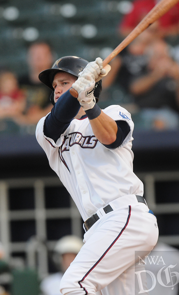 NWA Media/ J.T. Wampler - The Naturals' designated hitter Brian Fletcher makes a base hit Wednesday August 20, 2014 during their game against Springfield.