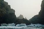 Ocean waves breaking over coastal rocks at Pfeiffer Beach, Big Sur Coast, Monterey County, California