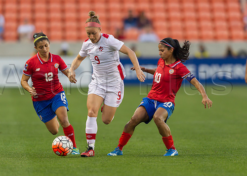 19.02.2016. Houston, TX, USA.  Costa Rica Defender Lixy Rodríguez (12) and Canada Defender Josée Belanger (9) during the Women's Olympic semi-final qualifying game between Canada and Costa Rica at BBVA Compass Stadium in Houston, Texas.