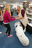 Pictured: Hollie Evans and Sarah Flatcher with Cyril the Swan. Friday 24 August 2018<br /> Re: Swansea City FC third kit launch at the club shop, Liberty Stadium, Swansea, Wales, UK.