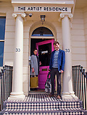 ENGLAND, Brighton, Guests in front of the Artist Residence