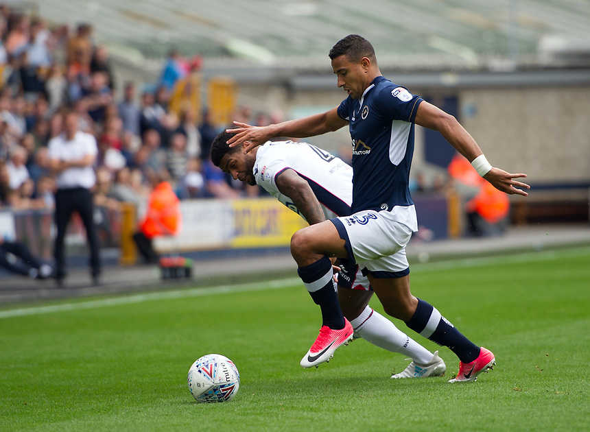 Bolton Wanderers' Mark Little battles for possession with Millwall's James Meredith<br /> <br /> Photographer Ashley Western/CameraSport<br /> <br /> The EFL Sky Bet Championship - Millwall v Bolton Wanderers - Saturday August 12th 2017 - The Den - London<br /> <br /> World Copyright &not;&copy; 2017 CameraSport. All rights reserved. 43 Linden Ave. Countesthorpe. Leicester. England. LE8 5PG - Tel: +44 (0) 116 277 4147 - admin@camerasport.com - www.camerasport.com