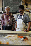 Robert Schuffler, 90, a Latvian immigrant and retired fishmonger with his protege, close friend and the man who eventually came to take over his business, Arturo Venegas, 39, a Mexican immigrant at Robert's Fish Market, a kosher fish store, at 2916 W. Devon Ave. in the West Rogers Park neighborhood of Chicago on July 18, 2008.  Indian, Pakistani, Muslim and Jewish, Devon Avenue in the West Rogers Park neighborhood is an eclectic representation of the world.