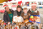 Getting ready for the Christmas farmers market in Listowel in front are Ronan Forde Maurice Hannon, Ella O'Sullivan and Thomas O'Connor.