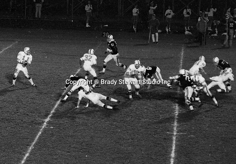 Bethel Park PA:  Offensive play with the Bethel Park offense setting up for another successful play,  Others in the  photo; Chip Huggins 32, Clark Miller 30, Dan Hannigan 64, Dennis Franks 66, Don Troup 51, Joe Barrett 75, Jim Dingeldine 73, Dan Hannigan 64, Mike Stewart 11.  The Bethel Park offense and defense played very well in the 16-0 shut out of the Upper St Clair Panthers.  The defensive unit was one of the best in Bethel Park history only allowing a little over 7 points a game.