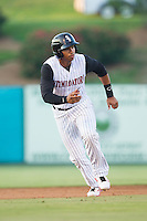 Tyler Williams (6) of the Kannapolis Intimidators takes his lead off of second base against the Greensboro Grasshoppers at CMC-Northeast Stadium on June 14, 2014 in Kannapolis, North Carolina.  The Grasshoppers defeated the Intimidators 4-2.  (Brian Westerholt/Four Seam Images)