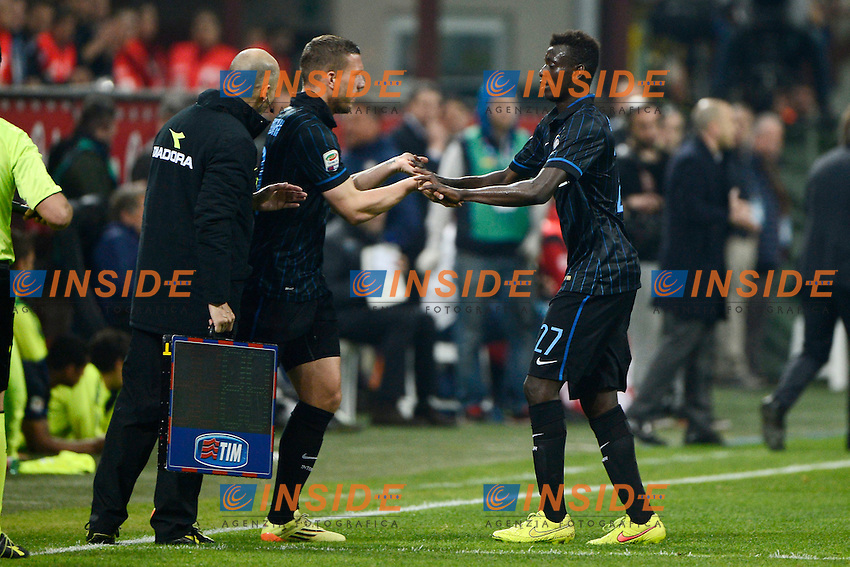 Lukas Podolski, Assane Demoya Gnoukouri inter<br /> Milano 25-04-2015 Stadio Giuseppe Meazza - Football Calcio Serie A Inter - Roma. Foto Giuseppe Celeste / Insidefoto