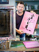 Ron Liberti, a local artist, prepares intricately screenprinted posters for Cats Cradle concerts.