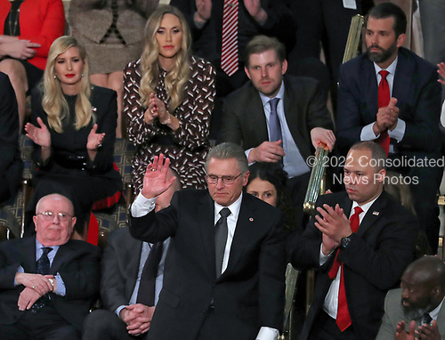 Tom Wibberley, lower center, the father of Navy Seaman Craig Wibberley, a Seaman killed on the USS Cole in Yemen on October 12, 2000, acknowledges the audience's applause after being introduced by United States President Donald J. Trump during his second annual State of the Union Address to a joint session of the US Congress in the US Capitol in Washington, DC on Tuesday, February 5, 2019.  At lower left is Judah Samet and at lower right is Elvin Hernandez.  Pictured behind Mr. Hernandez, from left to right, are: First Daughter and Advisor to the President Ivanka Trump, Lara Trump, Eric Trump and Donald J. Trump, Jr.<br /> Credit: Alex Edelman / CNP