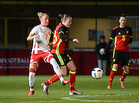 20161128 - TUBIZE ,  BELGIUM : Belgian Elien Van Wynendaele (R) and Danish Sanne Troelsgaard (L)  pictured during the female soccer game between the Belgian Red Flames and Denmark , a friendly game before the European Championship in The Netherlands 2017  , Monday 28 th November 2016 at Stade Leburton in Tubize , Belgium. PHOTO SPORTPIX.BE | DIRK VUYLSTEKE