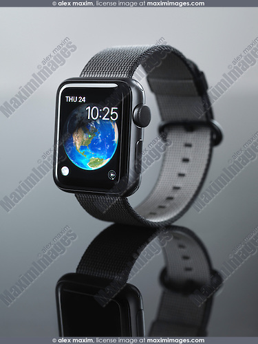Shiny steel Apple Watch series 2 smartwatch with clock displaying Earth globe on its display isolated on gray background