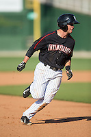 Eddy Alvarez (1) of the Kannapolis Intimidators hustles towards third base against the West Virginia Power at CMC-Northeast Stadium on April 21, 2015 in Kannapolis, North Carolina.  The Power defeated the Intimidators 5-3 in game one of a double-header.  (Brian Westerholt/Four Seam Images)