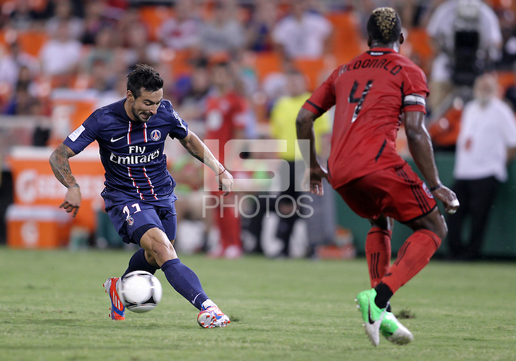 WASHINGTON, DC - July 28, 2012:  Brandon McDonald (4) of DC United watches Ezequiel Lavezzi (11) of PSG (Paris Saint-Germain) in an international friendly match at RFK Stadium in Washington DC on July 28. The game ended in a 1-1 tie.