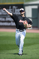 Myles Jaye (14) of the Birmingham Barons throws in the outfield prior to the game against the Tennessee Smokies at Regions Field on May 3, 2015 in Birmingham, Alabama.  The Smokies defeated the Barons 3-0.  (Brian Westerholt/Four Seam Images)