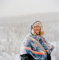 Sami reindeer herder dressed in Gakti, traditional dress, Lapland, Sweden