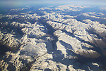 View from plane of snow covered mountain peaks in the Alps between France and Italy