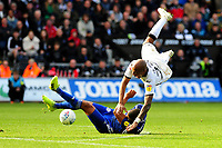 Andre Ayew of Swansea City is fouled by Lee Peltier of Cardiff City during the Sky Bet Championship match between Swansea City and Cardiff City at the Liberty Stadium in Swansea, Wales, UK. Sunday 27 October 2019
