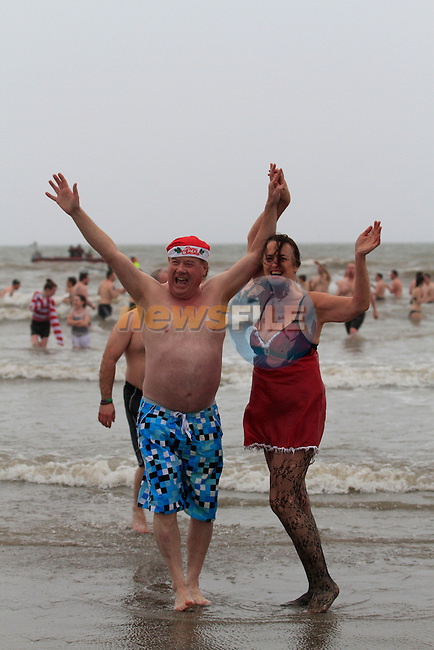 Frank Godfrey and Caroline Kavanagh at the St.Stephens Day Swim for Chernobyl on Clogherhead Beach...Photo NEWSFILE/Jenny Matthews..(Photo credit should read Jenny Matthews/NEWSFILE)