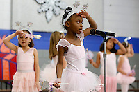 NWA Media/DAVID GOTTSCHALK - 12/16/14 - Makaylah Tharpe, a first grade student at Asbell Elementary School in Fayetteville performs with three first grade classes Tuesday December 16, 2014. The theme of the performance was Miss Popinger's Christmas under the direction of music teacher Carlena Lambert.