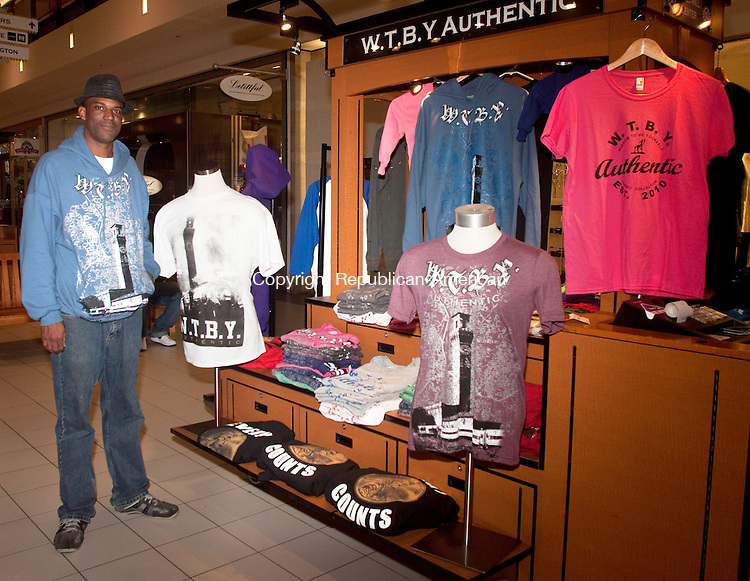 WATERBURY- OCTOBER 01 2014 100114DA01-  Henry Lee Jr. of Waterbury has a new WTBY Authentic kiosk at the Brass Mill Center mall offering Waterrbury-centric clothing.<br /> Darlene Douty Republican American