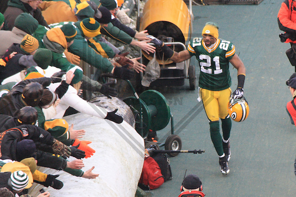 GREEN BAY - DECEMBER 2009: Charles Woodson #21 of the Green Bay Packers takes a victory lap following a game on December 27, 2009 at Lambeau Field in Green Bay, Wisconsin. (Photo by Brad Krause)