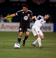 Jaime Moreno (99) of D.C. United pulls away from Ned Grabavoy (20) of Real Salt Lake during a U.S. Open Cup tournament game at RFK Stadium in Washington, DC.  D.C. United defeated Real Salt Lake, 2-1, in overtime.
