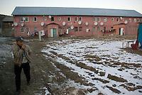 ROMANIA, 01.2009, Aninoasa..Man leaving home, Aninoasa, Hunedoara county, Romania..© Egyed Ufo Zoltan / Est&Ost Photography