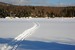 Snowmobile Trail Leading across the Lake to an Ice Fishing Shed