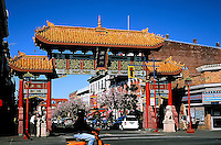 Gateway to Chinatown, Victoria, BC, with cherry trees blooming in Spring.