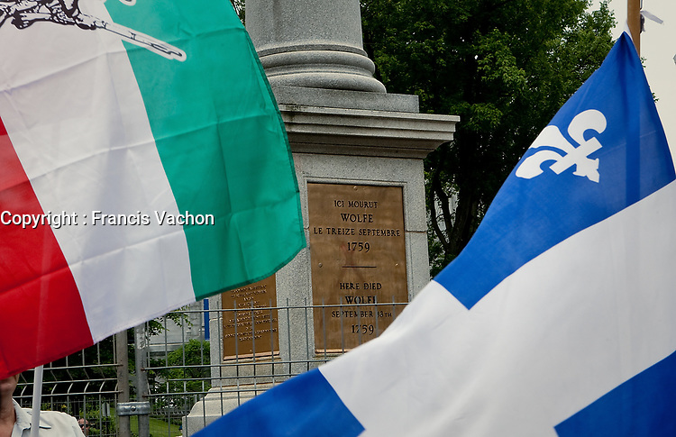 "A Quebec and a ""patriot"" flag fly in front of Wolfe's monument on the Plains of Abraham in Quebec city July 1, 2009. The RRQ held their annual protest against Canada by collecting Canada flags to ""send them back to the sender"".<br /> <br /> PHOTO :  Francis Vachon - Agence Quebec Presse"