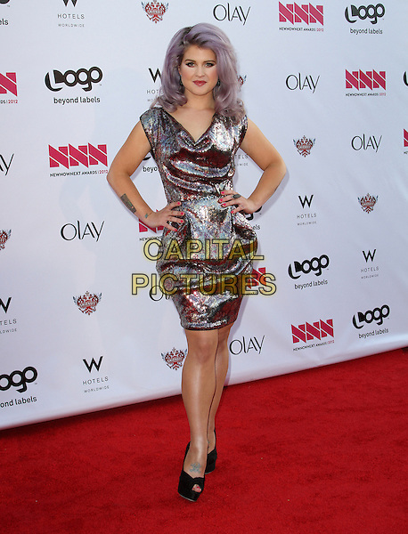 Kelly Osbourne.LOGO's 2012 'NewNowNext' Awards held at Avalon, Hollywood, California, USA..5th April 2012.full length dress hands on hips gold silver purple dyed lilac hair.CAP/ADM/FS.©Faye Sadou/AdMedia/Capital Pictures.