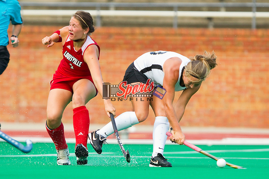 Lizzie Rae #23 of the Wake Forest Demon Deacons shoots the ball past Dominique Pasqualichio #1 of the Louisville Cardinals at Kentner Stadium on September 4, 2011 in Winston-Salem, North Carolina.  The Demon Deacons defeated the Cardinals 3-2 in overtime.  (Brian Westerholt / Sports On Film)