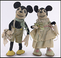 BNPS.co.uk (01202 558833)Pic: Burstow&amp;Hewett/BNPS<br /> <br /> The royal children's Mickey and Minnie Mouse dolls.<br /> <br /> The Queen's garments given to her by the former royal nurse - Clara Knight<br /> <br /> Five of the Queen's dolls and a selection of her childhood clothes have emerged for sale.<br /> <br /> The garments and toys were given to the former royal nurse Clara Knight who looked after Queen Elizabeth in her early years while the Queen Mother was undertaking ceremonial duties.<br /> <br /> There are approximately 20 garments in the collection including infants dresses and matching undergarments, many in silks and linen and some in early man made fabrics.