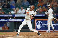 Duke Ellis (11) of the Texas Longhorns at bat against the Arkansas Razorbacks in game six of the 2020 Shriners Hospitals for Children College Classic at Minute Maid Park on February 28, 2020 in Houston, Texas. The Longhorns defeated the Razorbacks 8-7. (Brian Westerholt/Four Seam Images)