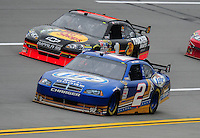 Oct. 30, 2009; Talladega, AL, USA; NASCAR Sprint Cup Series driver Kurt Busch (2) races alongside Martin Truex Jr during practice for the Amp Energy 500 at the Talladega Superspeedway. Mandatory Credit: Mark J. Rebilas-