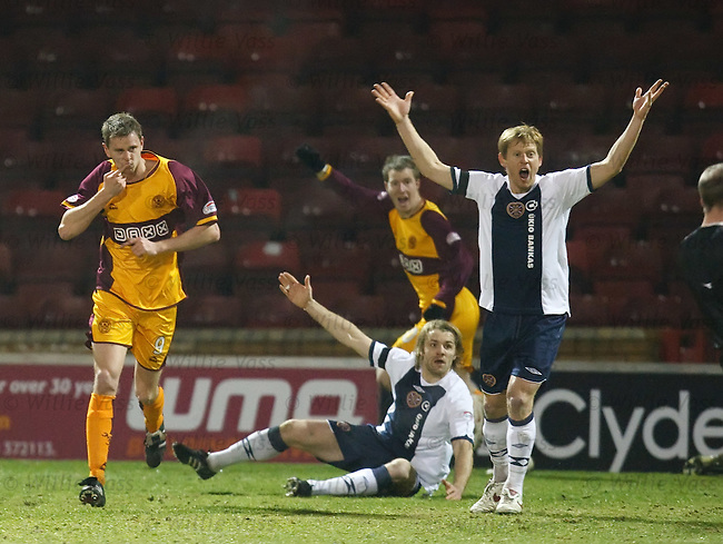 Chris Porter celebrates his goal as Robbie Neilson and Michael Stewart complain