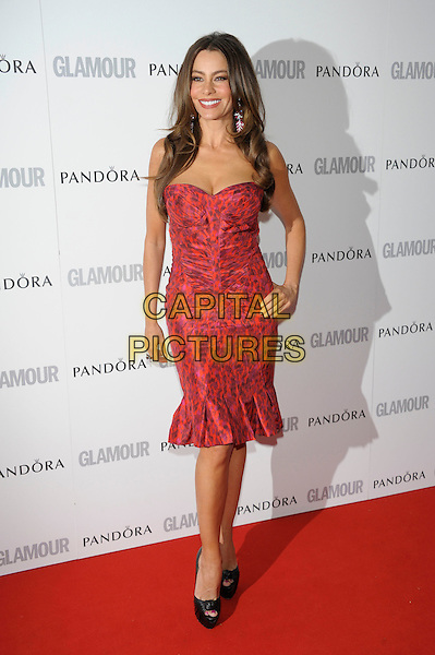 Sofia Vergara.Women Of The Year 2012 - Glamour Awards, Berkeley Square, London, England..29th May 2012.full length red strapless print dress hand on hip ruched viagra black peep toe shoes.CAP/PL.©Phil Loftus/Capital Pictures.