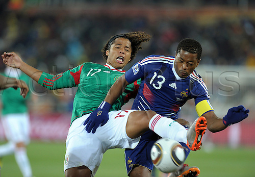 Giovani DOS SANTOS (l./ MEX) challenges with Patrice EVRA (FRA).Match 18: France - Mexico, Polokwane, 17th June 2010--.FIFA- Soccer World Championship 2010 in South Africa..