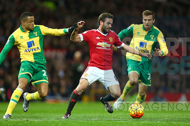 Juan Mata of Manchester United escapes Norwich's Gary O'Neil and Nathan Redmond - Manchester United vs Norwich City - Barclays Premier League - Old Trafford - Manchester - 19/12/2015 Pic Philip Oldham/SportImage