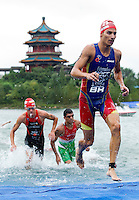 10 SEP 2011 - BEIJING, CHN - Mario Mola (ESP) (right) heads for transition after completing the swim during the 2011 Elite Mens ITU World Championship Series Grand Final Triathlon .(PHOTO (C) NIGEL FARROW)