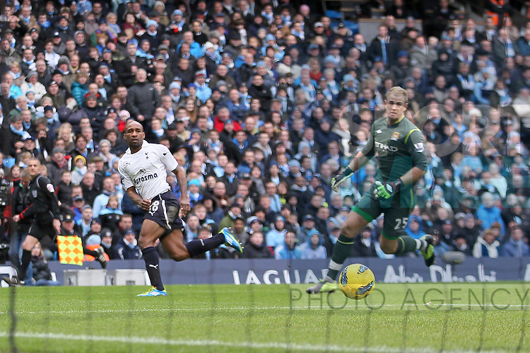 Spurs Jermain Defoe scoring his sides opening goal..Manchester City v Tottenham Hotspur in the the Barclays Premier League, at the Etihad Stadium, Manchester. 22nd January 2012.--------------------.Sportimage +44 7980659747.picturedesk@sportimage.co.uk.http://www.sportimage.co.uk/.Editorial use only. Maximum 45 images during a match. No video emulation or promotion as 'live'. No use in games, competitions, merchandise, betting or single club/player services. No use with unofficial audio, video, data, fixtures or club/league logos.