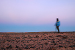 A man walks on December 18, 2003, in the Saharawi refugee camps in Aljer. Saharawi people have been living at the refugee camps of the Algerian desert named Hamada, or desert of the deserts, for more than 30 years now. Saharawi people have suffered the consecuences of European colonialism and the war against occupation by Moroccan forces. Polisario and Moroccan Army are in conflict since 1975 when Hassan II, Moroccan King in 1975, sent more than 250.000 civilians and soldiers to colonize the Western Sahara when Spain left the country. Since 1991 they are in a peace process without any outcome so far. (Ander Gillenea / Bostok Photo)
