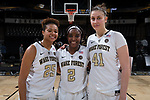 (L-R) Ariel Stephenson (25), Amber Campbell (2), and Elisa Penna (41) pose for a photo following the game against the Virginia Cavaliers at the LJVM Coliseum on February 25, 2018 in Winston-Salem, North Carolina. This is the first time in program history that the Demon Deacons have three active 1,000 point scorers on the roster at the same time. (Brian Westerholt/Sports On Film)