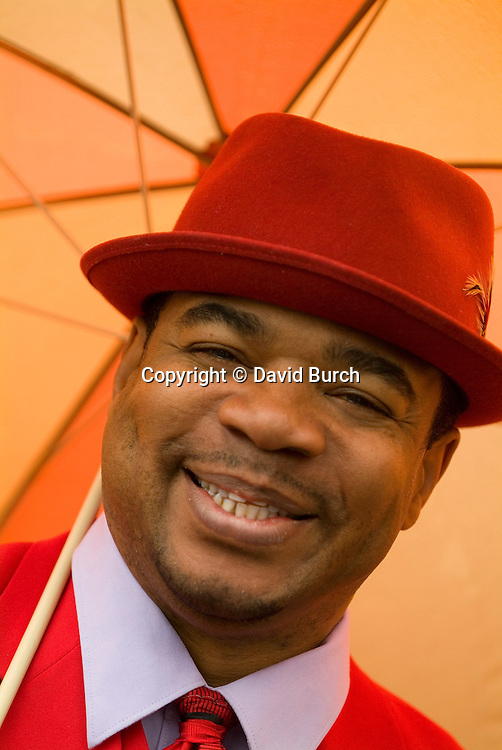 African American man in red hat, smiling, close-up, portrait