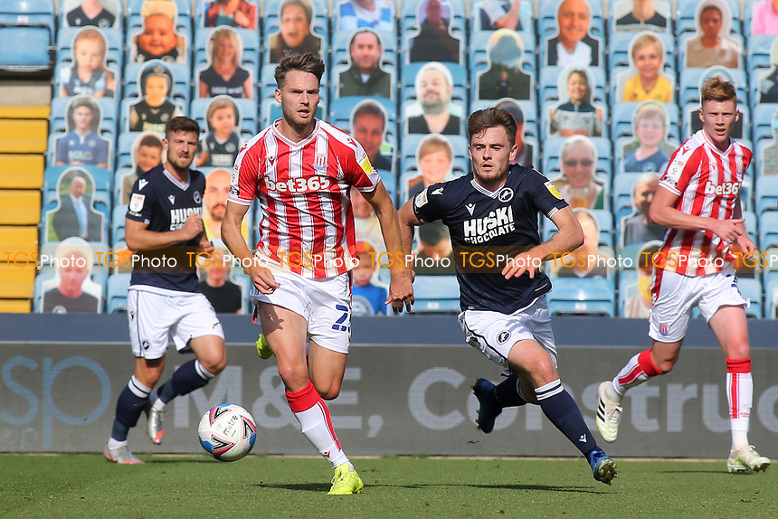 Nick Powell of Stoke City and Millwall's Ben Thompson challenge for the ball during Millwall vs Stoke City, Sky Bet EFL Championship Football at The Den on 12th September 2020